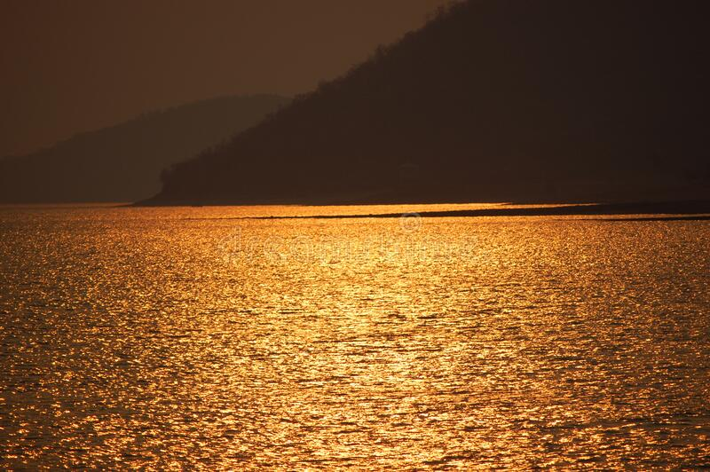 Blue Sea Near Brown Mountain During Sunset Free Public Domain Cc0 Image