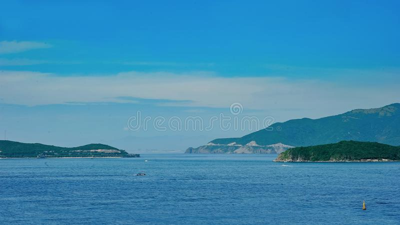 Blue Sea Near Mountains stock photos