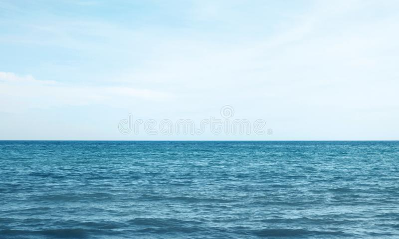 Blue sea or ocean with sky. Vacation, travel and background concept - blue sea or ocean with sky royalty free stock photo