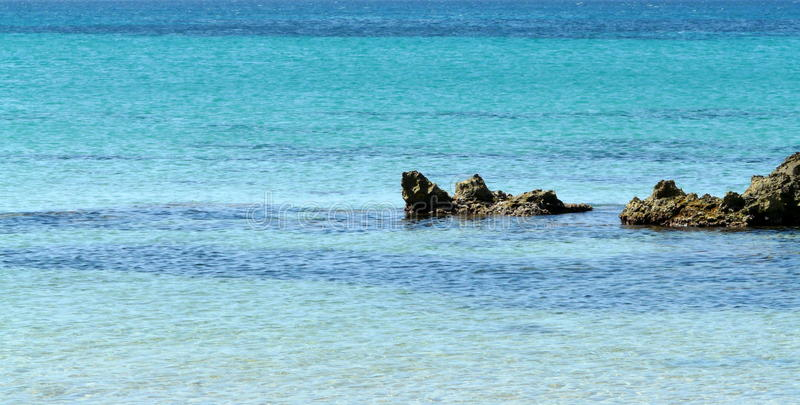 A blue sea and rocks nature background stock photo