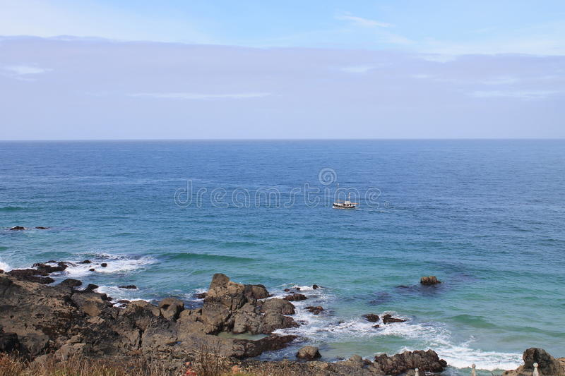 Blue sea and rocky coast at Cornwall, England royalty free stock photography