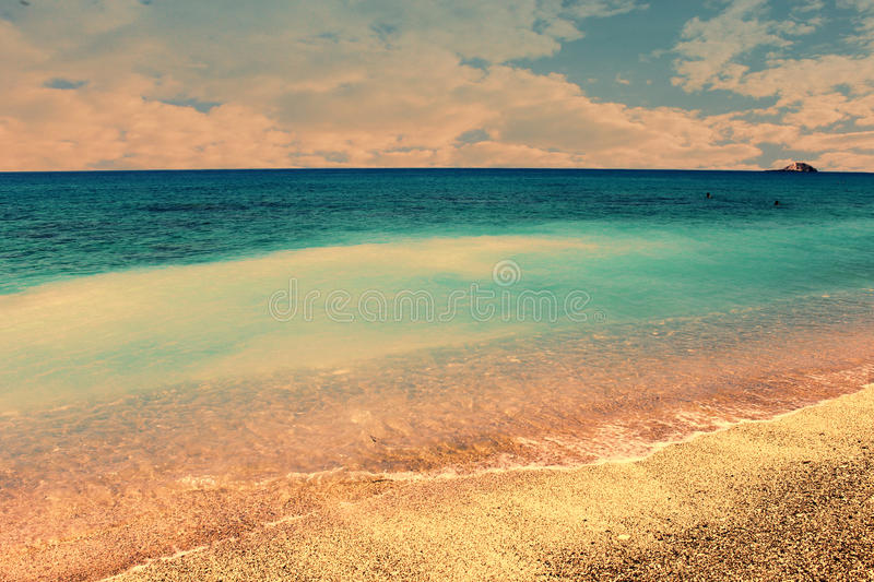 Blue sea. Royal blue waves and stunning beach royalty free stock photography