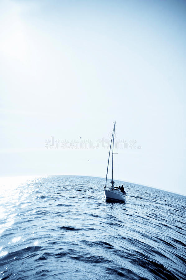 Download Blue sea with sailboat stock image. Image of photo, horizon - 25123059