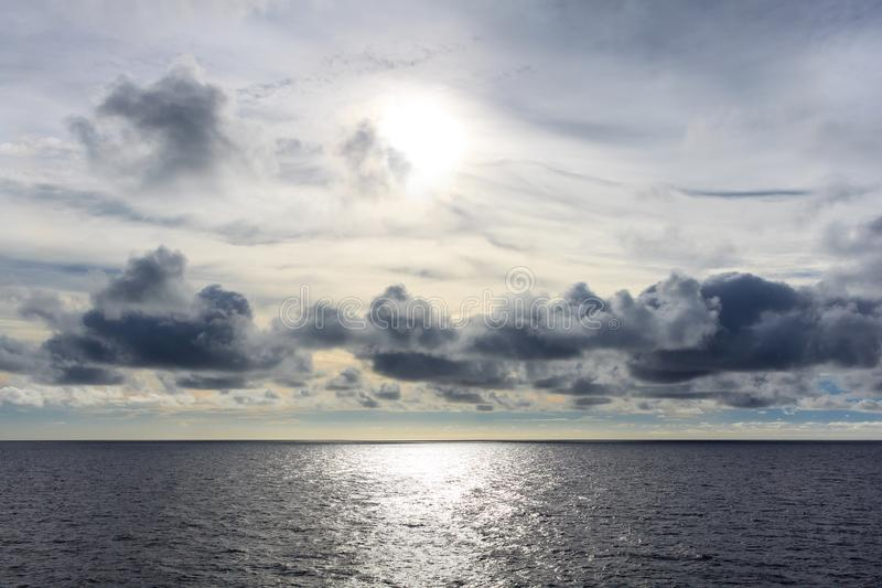 Blue sea and blue sky with white cloud. royalty free stock photography