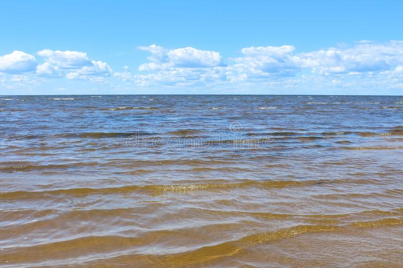 Blue sea and sky with white clouds background. royalty free stock photography