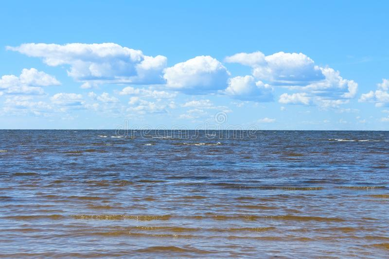 Blue sea and sky with white clouds background. royalty free stock image