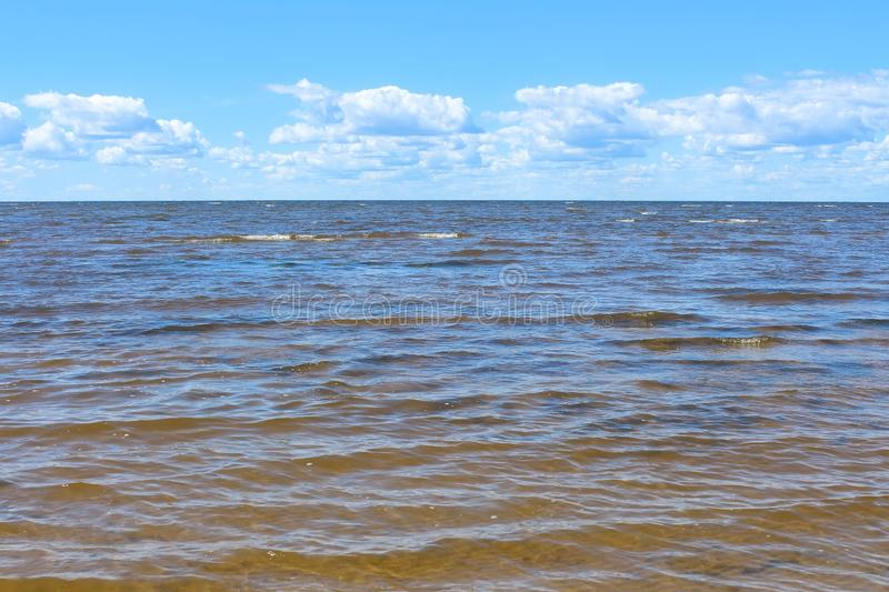 Blue sea and sky with white clouds background. royalty free stock photo