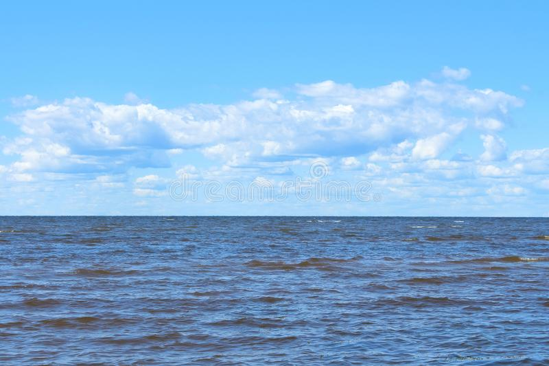 Blue sea and sky with white clouds background. stock photo