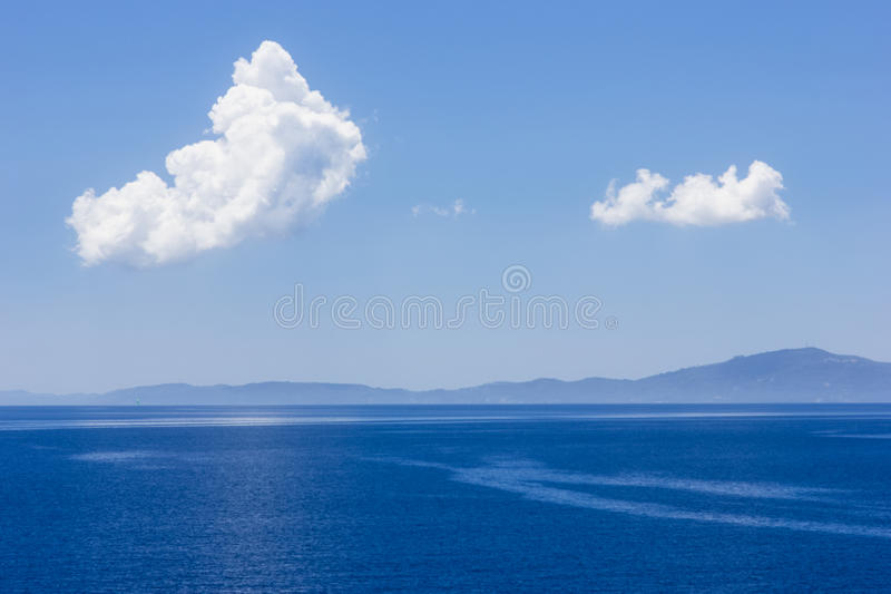 View of an open sea with a cloud royalty free stock image