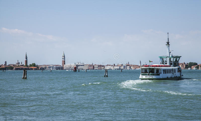 Blue sea - Venice, Italy/water bus and the city towers. royalty free stock photography