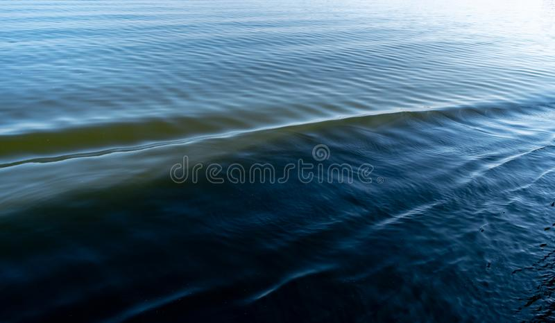 Blue sea water in calm. Ocean Waves Abstract Background Texture stock photo
