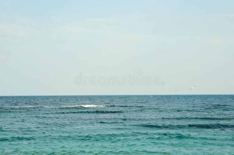Blue sea water with small waves against sky. Space for text royalty free stock images