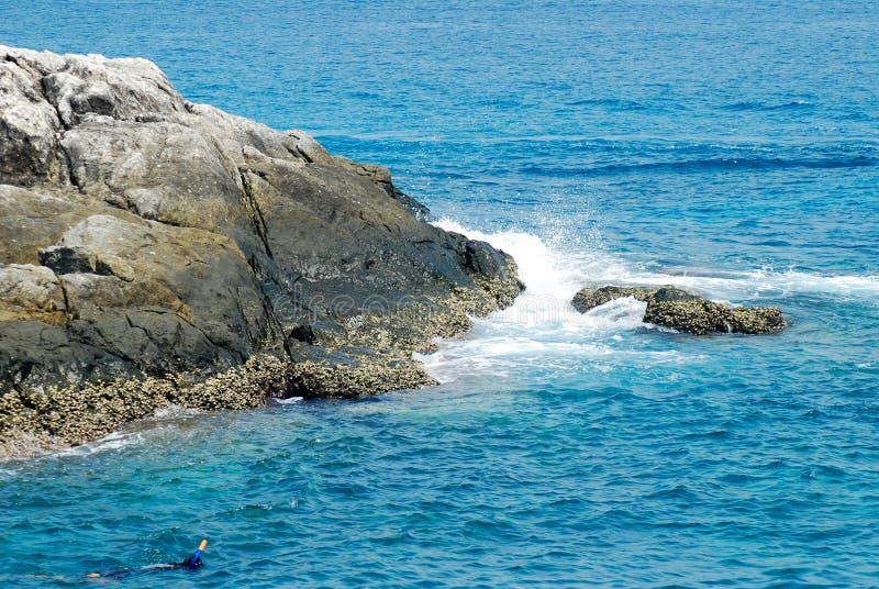 Blue sea waves crashing on the rocks royalty free stock image