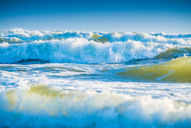 Blue sea waves. Blue sea or ocean waves and sky royalty free stock photo