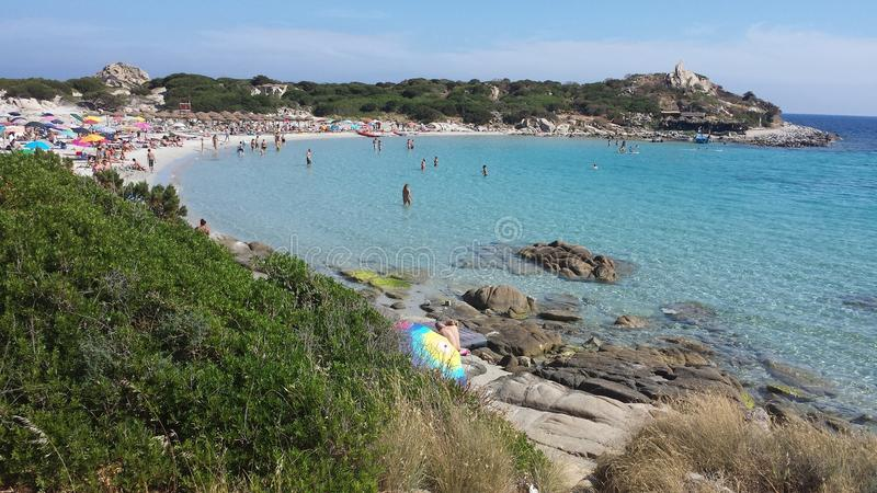 Blue Sea and white Beach and people At Villasimius (Sardinia) stock images