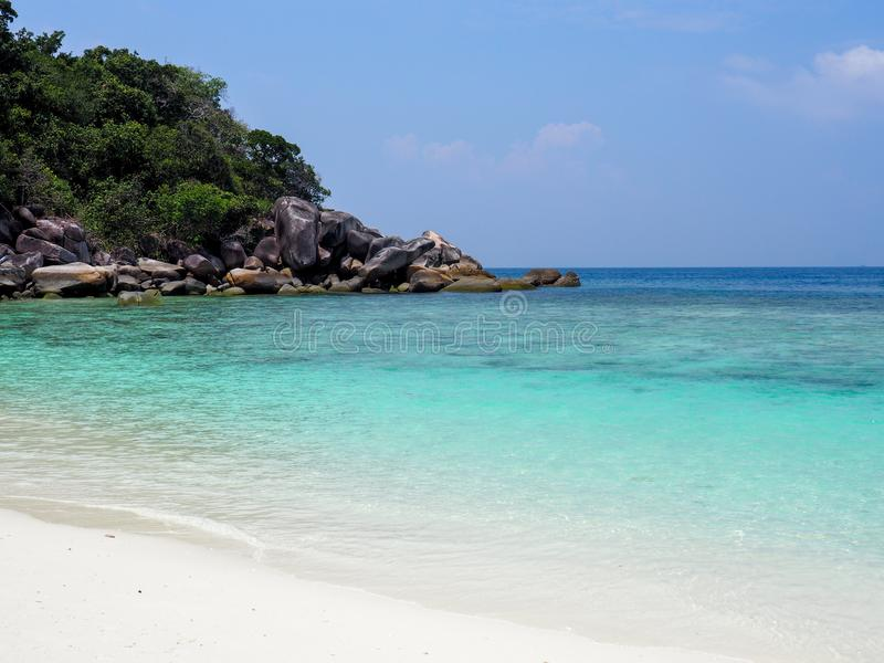 Blue sea and white sand beach with blue sky stock photo