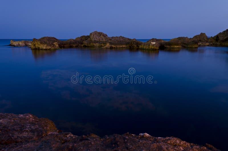 Blue seas in Ghar Lapsi - Malta. Blue seas in the evening at Ghar Lapsi in Malta royalty free stock images