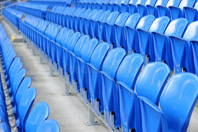 Blue seats in stadium. Rows of blue seats in football or soccer stadium royalty free stock photos