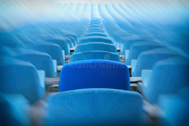 Blue seats on the stadium.  Sport events, match. Tickets, fans, final, seats. Empty seats. Empty seats. Tickets, fans, final, seats. Choose your best seat of stock images