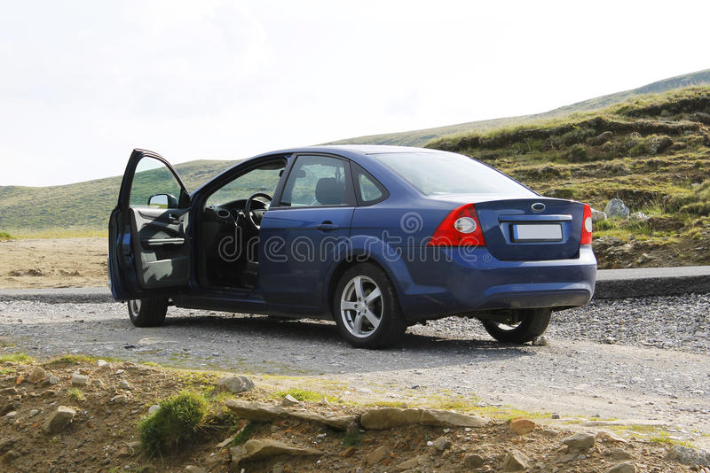 Blue sedan car from back, open door royalty free stock photo