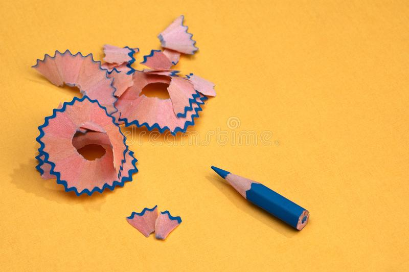 Blue sharpened pencil with shavings stock photo