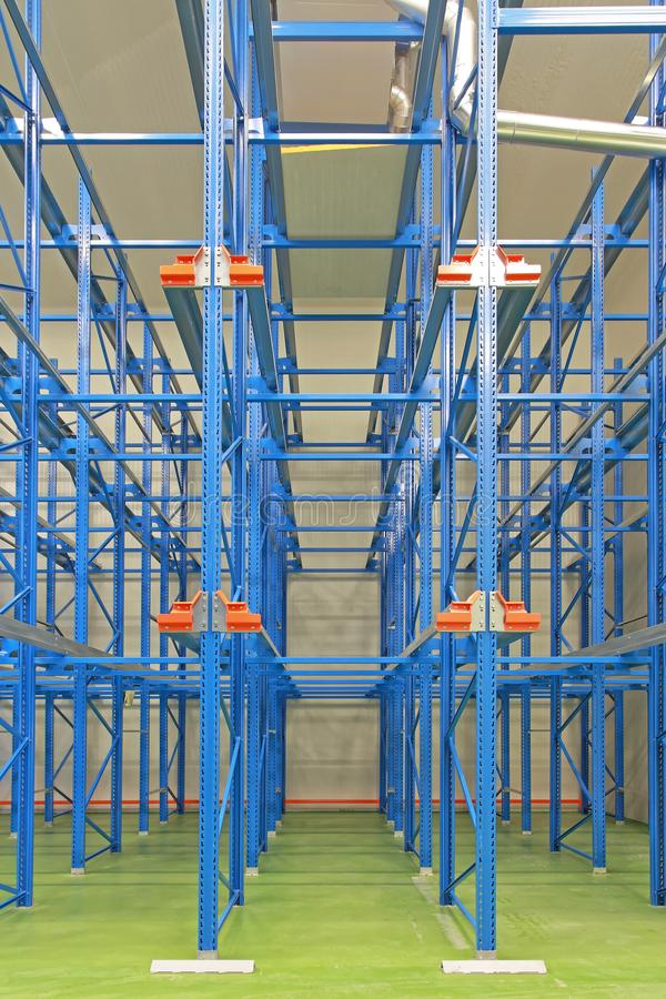 Shelving system warehouse. Blue shelves in new distribution center warehouse royalty free stock image