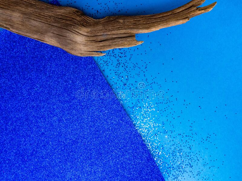 Blue shiny cardboard background, and wooden decorative elements, trendy color of 2020 year. Blue shiny cardboard background for design, and wooden decorative stock images