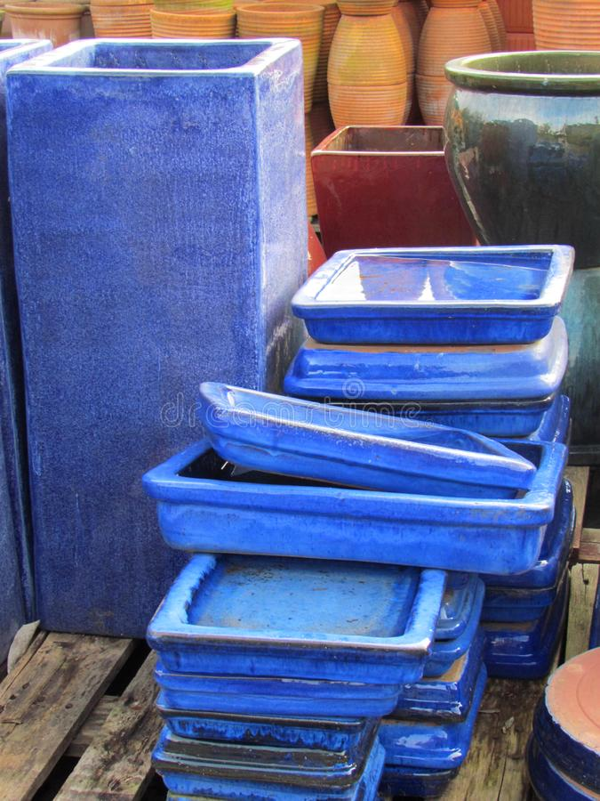 Blue ceramic rectangular plates and vases royalty free stock photo