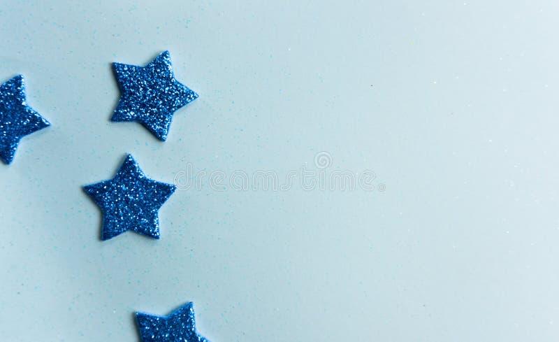 Blue shiny stars background stock photography