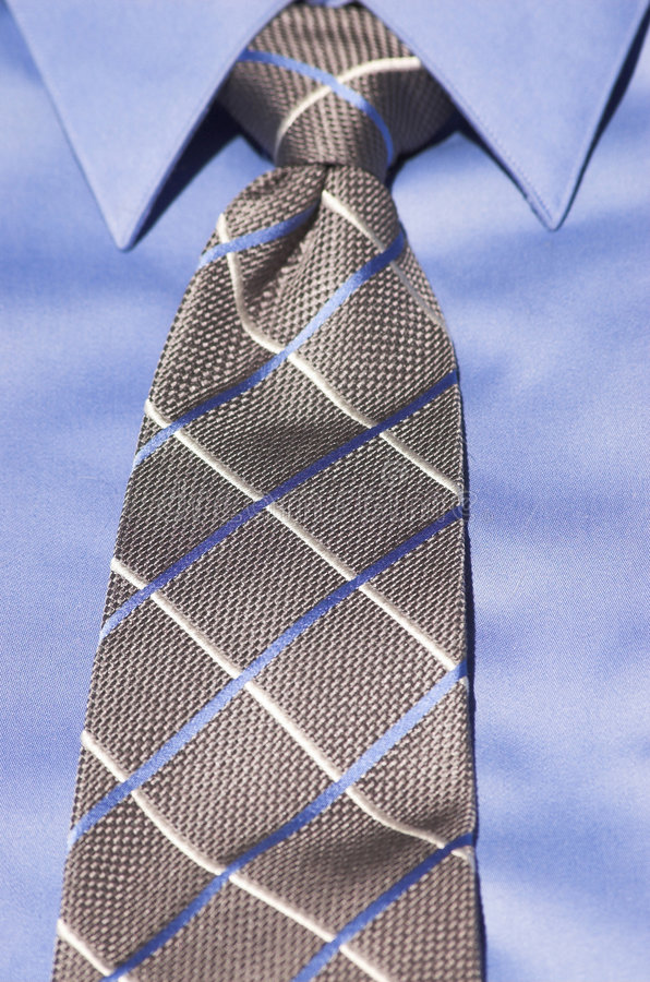 Blue shirt with striped tie stock photos