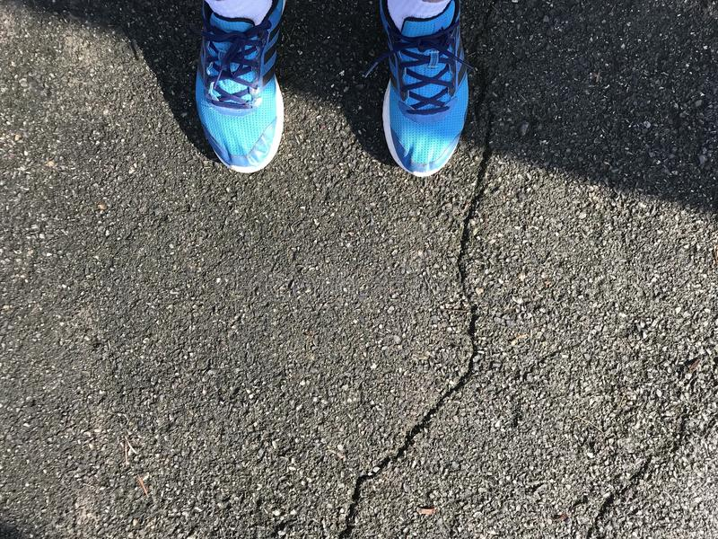 Blue shoes running royalty free stock photo
