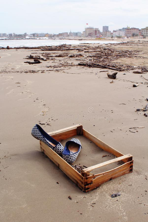 Blue shoes on the beach royalty free stock images