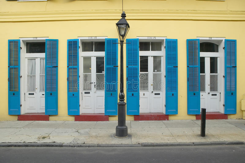 Blue shutter and lamp post in French Quarter near Bourbon Street in New Orleans, Louisiana stock images