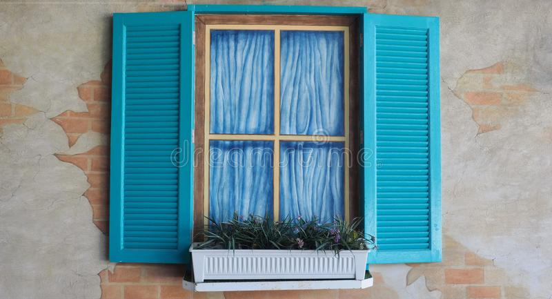 Blue shutters and faux windows stock photography