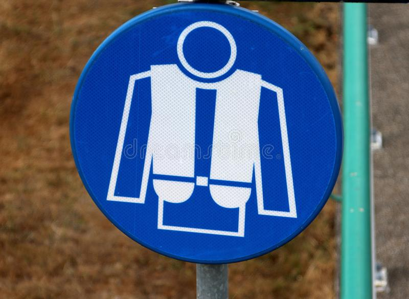 Blue sign that a life jacket is mandatory in the sluice in Lemmer in the Netherlands.  stock images