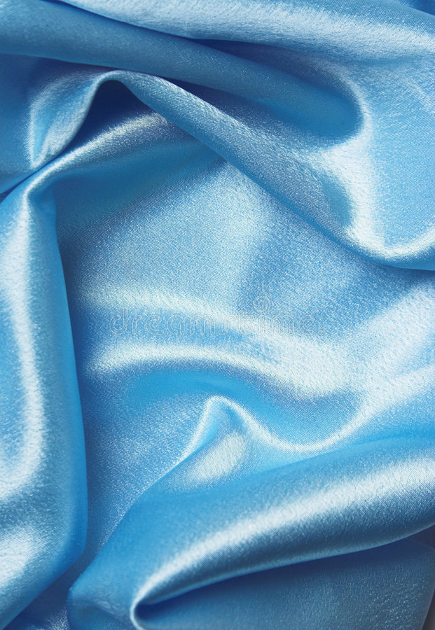 Blue silk. Folded cloth, soft and shiny royalty free stock images