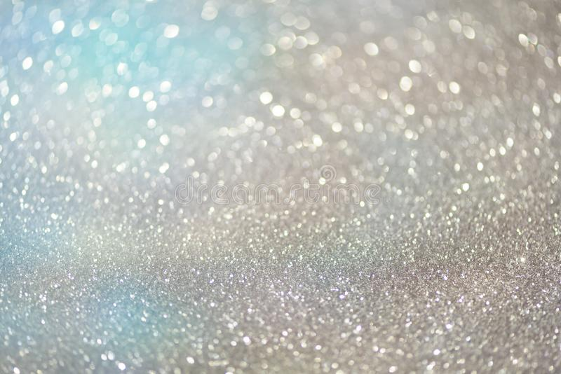 Blue and silver abstract bokeh lights. Shiny glitter background with copy space. New year and Christmas concept. Sparkling royalty free stock photography