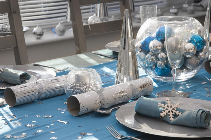 Blue and silver Christmas dinner table royalty free stock photo