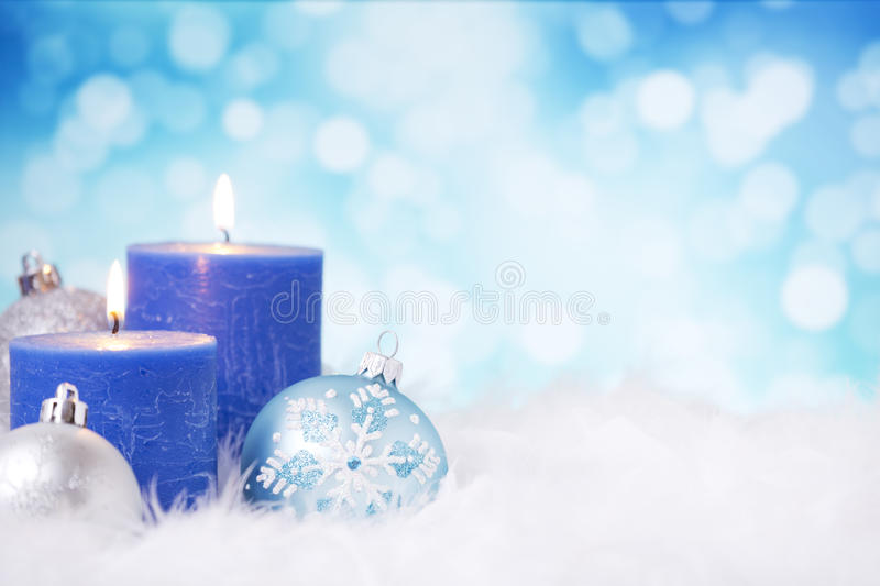 Blue and silver Christmas scene with baubles and candles royalty free stock photo