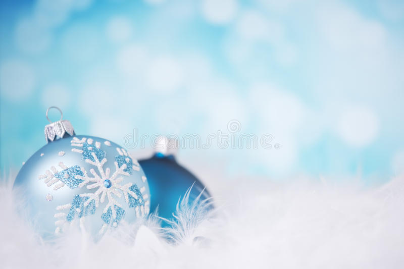 Blue and silver Christmas scene with baubles royalty free stock photography