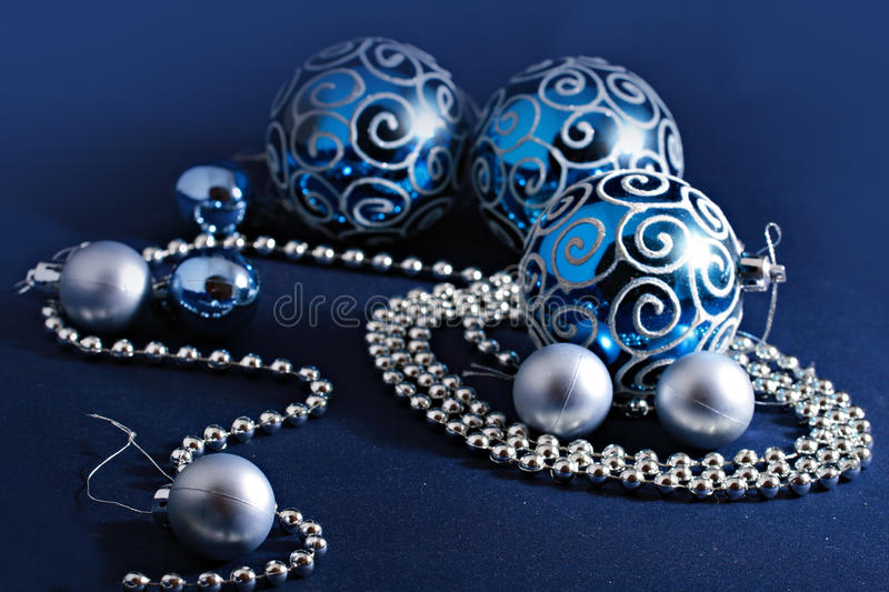 Christmas decorations in blue and silver colors stock photos