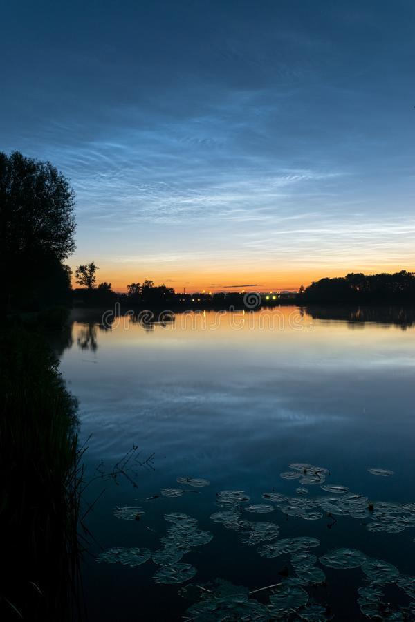 Silvery noctilucent clouds night shining clouds landscape over a dutch lake stock photography
