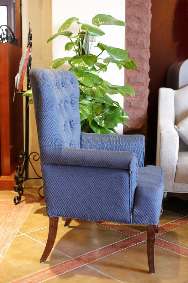 Blue single sofa. Blue fabric sofa in the room royalty free stock photography