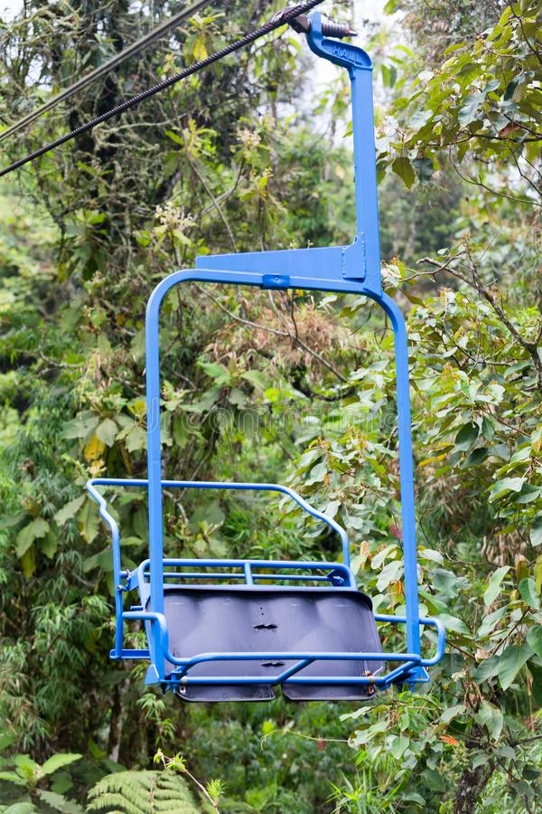 Blue ski lift. A closeup of a blue chair on the ski lift at the Recinto del Pensamiento nature reserve near Manizales, Colombia royalty free stock photo