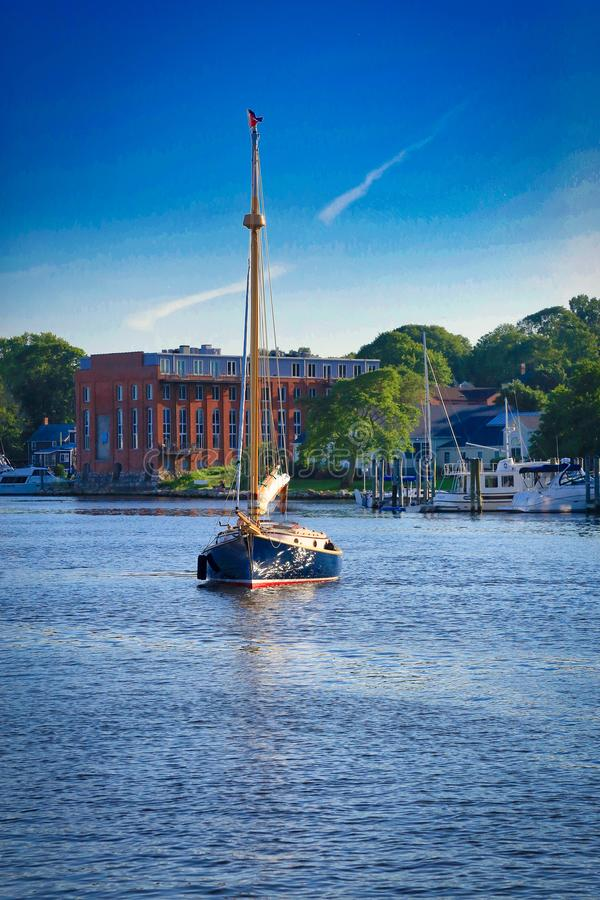 Sailboat tall Mystic Connecticut. Blue skies blue ocean large tall sailboat in Mystic Connecticut royalty free stock images