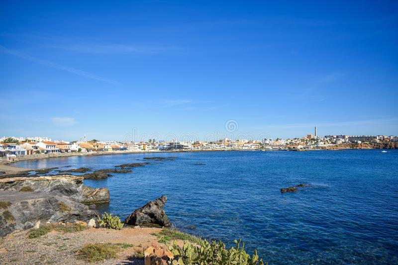 Houses on a rocky beachfront at Cabo de Palos, Spain royalty free stock image