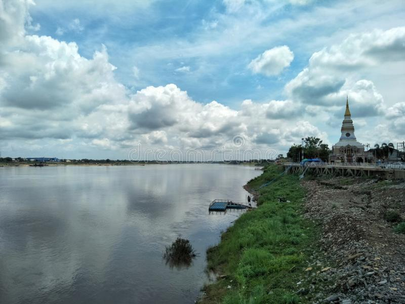 Blue skies with cloud and the Mekong river in Nong Khai province of Thailand. stock photo