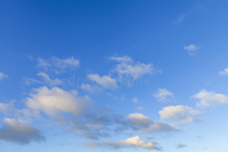Blue skies with a few white fluffy clouds 591. Blue skies with a few white fluffy clouds. Summer sky above Norfolk UK stock photography