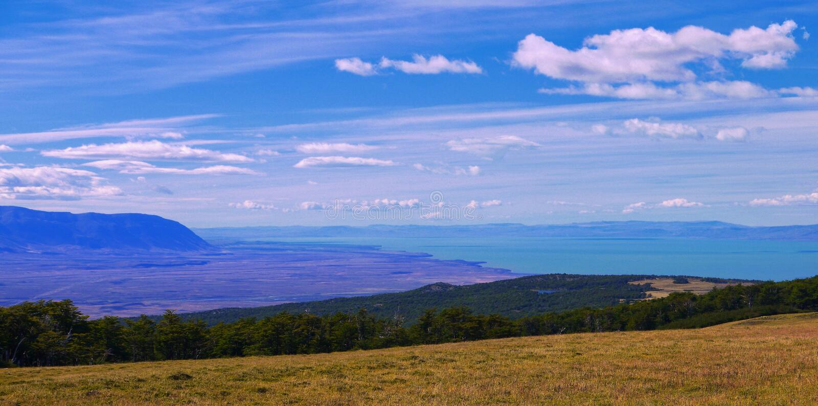 Blue skies, horizon and lago in Patagonia. Distant views of the blue Lago Viedma under blue skies near El Chalten Patagonia stock photography