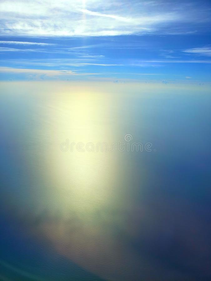 Blue skies over Pacific ocean stock images